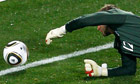 England's goalkeeper Robert Green concedes a howler against USA