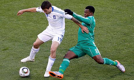 Greece's Socratis Papastathopoulos is tackled by Yakubu