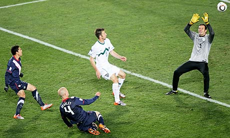 The USA's Michael Bradley scores his side's second goal past Samir Handanovic of Slovenia