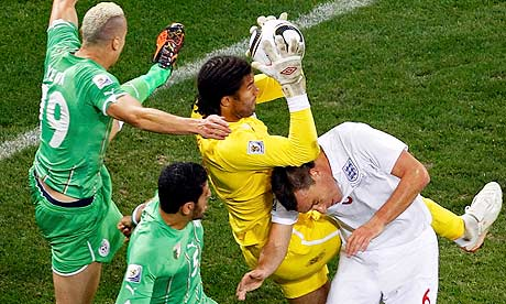 England's goalkeeper David James comes under pressure