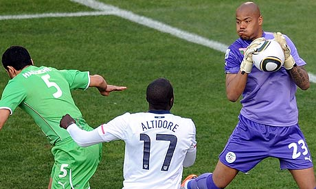 Algeria goalkeeper Rais M Bolhi makes a save