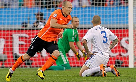 Arjen Robben celebrates scoring for Holland