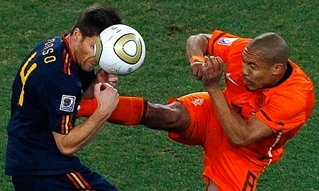 Xabi Alonso and Nigel de Jong