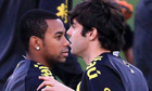 Brazil players Robinho and Kaka warm up