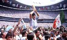 Maradona lifting the 1986 World Cup