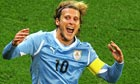 Diego Forlan of Uruguay celebrates
