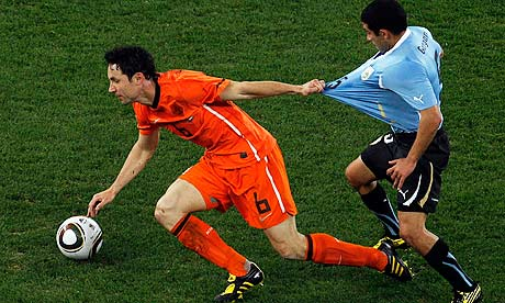 Mark van Bommel in action against Uruguay