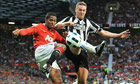 Manchester United's Antonio Valencia and Newcastle's Kevin Nolan battle for the ball