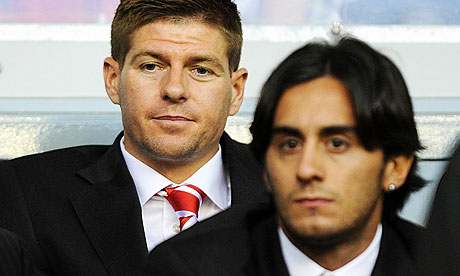 Liverpool's Steven Gerrard and Alberto Aquilani struggle to contain their excitement