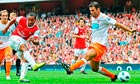 Arsenal's Theo Walcott shoots past the Blackpool defender Dekel Keinan to put his team 3-0 up