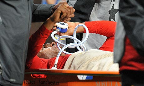 Manchester United's Antonio Valencia is stretchered off