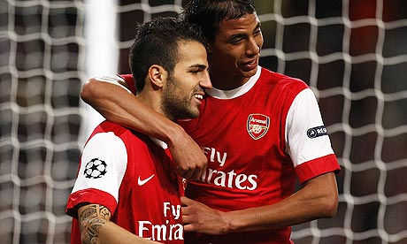 Cesc Fabregas celebrates with Marouane Chamakh
