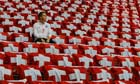 An England fan sits among Swiss flags