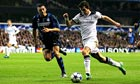 Gareth Bale of Tottenham Hotspur takes on Lucio of Inter