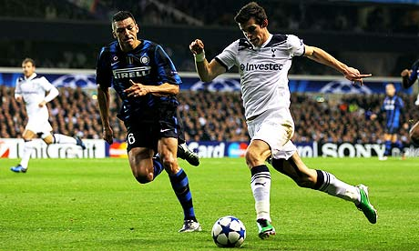 Gareth Bale of Tottenham Hotspur takes on Lucio of Inter