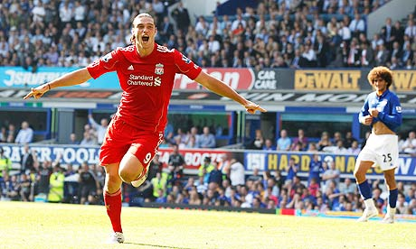 Liverpool's Andy Carroll celebrates putting his side 1-0 up at Everton