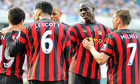 Manchester City's Italian striker Mario Balotelli, second right, celebrates with team-mates