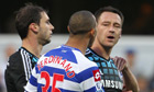 The Chelsea captain John Terry speaking with QPR's Anton Ferdinand