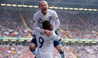 Wayne Rooney leaps on Darren Bent after scoring the second England goal against Wales