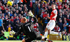 Arsenal's Robin van Persie scores his second goal against Norwich City