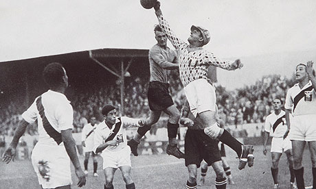 The Peruvian goalkeeper punches clear an Austrian attack during their match at the 1936 Games