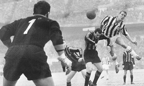 John Charles rises high to score on a snowy surface for Juventus against Internazionale