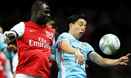 Arsenal's Emmanuel Frimpong and Manchester City's Samir Nasri battle for the ball