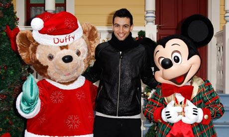 Paris St Germain's Javier Pastore poses with Disney mascots