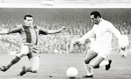 Segarra of Barcelona attempted to tackle Francisco Gento
