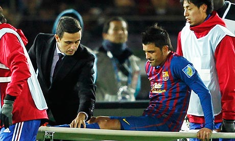 David Villa is carried off on a stretcher