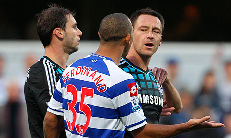 John Terry, who has denied making a racial slur against Anton Ferdinand, with the QPR player