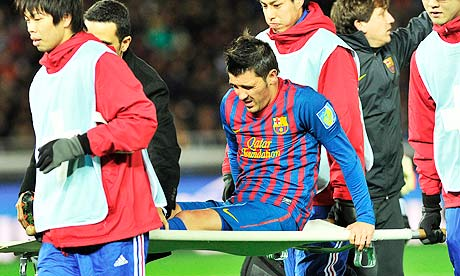 Barcelona's David Villa is carried off after breaking his left leg against Al Sadd