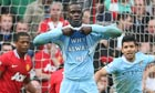Mario Balotelli shows a t-shirt with the message 'Why always me?'
