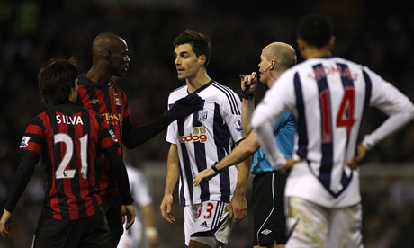 West Bromwich's Paul Scharner has words with Manchester City's Mario Balotelli.