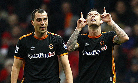 Steven Fletcher (right) celebrates after scoring Wolves' equaliser against Arsenal