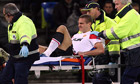Nemanja Vidic departs Manchester United's game against Basel on a stretcher