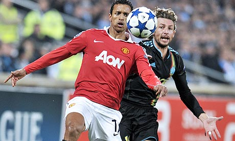 Manchester's United Nani and Gabriel Heinze of Marseille
