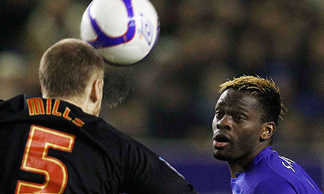 Everton's Louis Saha challenges Matt Mills