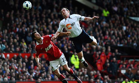 Jonny Evans challenges Kevin Davies