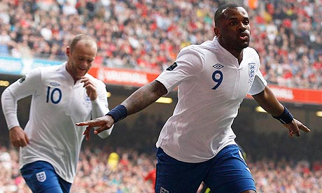 England's Darren Bent celebrates with Wayne Rooney