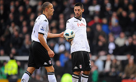 clint dempsey. Clint Dempsey hands the ball