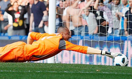 Tottenham's Heurelho Gomes tries to stop Frank Lampard's shot from crossing the line
