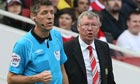 Sir Alex Ferguson speaks to assistant referee Lee Mason