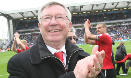 Sir Alex Ferguson celebrates a 19th title