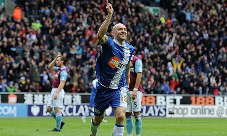 Wigan's Conor Sammon celebrates scoring his team's equaliser, against West Ham