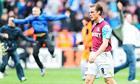 West Ham United's Scott Parker shows the pain of Premier League relegation as Wigan celebrate