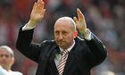 Blackpool manager Ian Holloway applauds the travelling fans