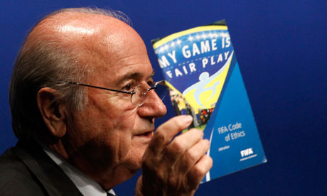 Sepp Blatter displays the FIFA booklet