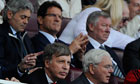 Stan Kroenke, bottom left, in front of Fabio Capello and Sir Alex Ferguson at Arsenal