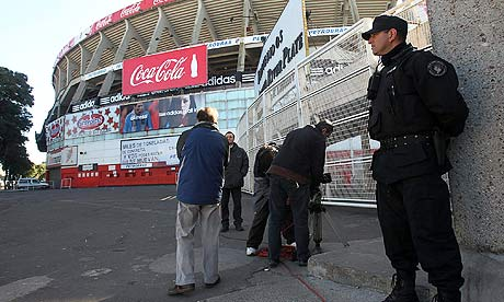 river plate stadium argentina. BST. A policeman stands
